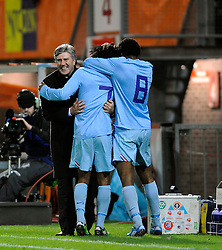 17-11-2009 VOETBAL: JONG ORANJE - JONG SPANJE: ROTTERDAM<br /> Nederland wint met 2-1 van Spanje / Georginio Wijnaldum scoort de 2-0 met een practige kopbal en viert dit met Cor Pot en Leroy Fer<br /> ©2009-WWW.FOTOHOOGENDOORN.NL