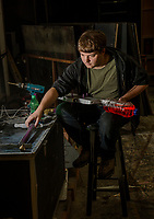 """Zach Glennon builds a """"ray gun"""" for a prop in the upcoming production of """"Rocky Horror Show"""" at the Winnipesaukee Playhouse opening June 14th.  (Karen Bobotas/for the Laconia Daily Sun)"""