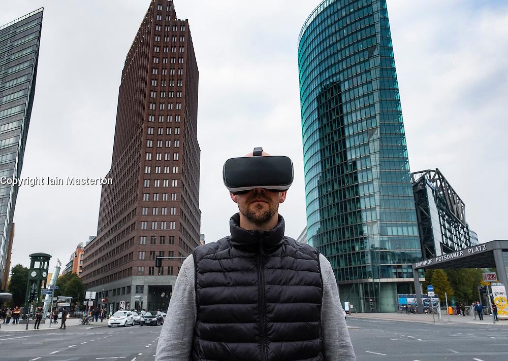 Man wearing Virtual Reality (VR) goggles at Potsdamer Platz in Berlin, Germany