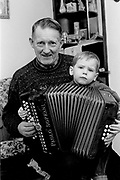Johnny O'Leary, Sliabh Luachra Musician with his grandson  in Killarney in 1990.<br /> Now & Then - MacMONAGLE photo archives.<br /> Picture by Don MacMonagle -macmonagle.com<br /> Facebook - @killarneynowandthen
