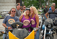 Bob and Nancy Jesson and Lita Caggiano Motroni gather with riders at Faro Italian Grille Saturday morning to join in the 13th annual Brenda's Ride with Friends.  Proceeds to benefit LRGHealthcare Oncology Department.  (Karen Bobotas/for the Laconia Daily Sun)