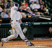 May 27, 2013; Houston, TX, USA; Colorado Rockies left fielder Carlos Gonzalez (5) hits a single to center field against the Houston Astros during the third inning at Minute Maid Park. Mandatory Credit: Thomas Campbell-USA TODAY Sports
