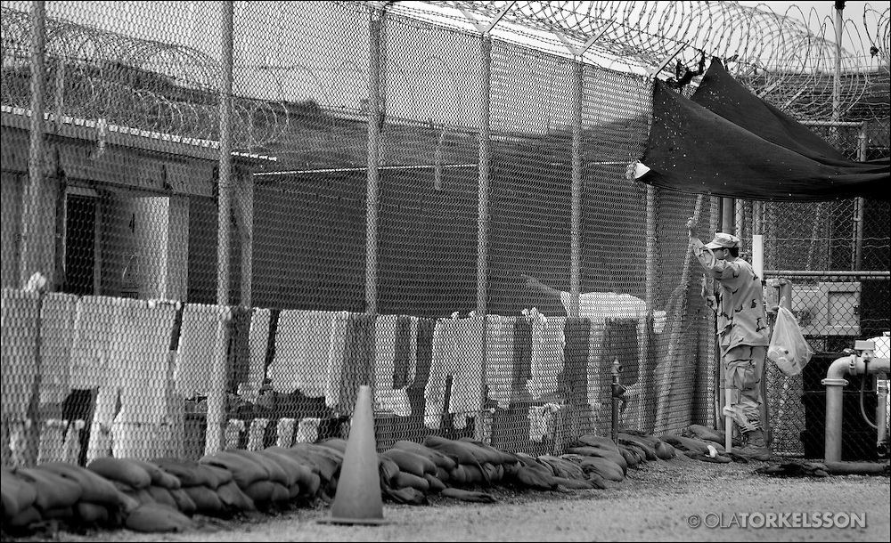 """In the aftermath of the Sept. 11, 2001, attacks on the United States, and after the American invasion of Afghanistan, prisoners suspected of being al Qaeda members or supporters were transported to the Guantánamo military prison. In 2002, President George W. Bush made it the central prison for suspects considered unlawful enemy combatants in the newly christened """"war on terror."""""""