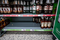 © Licensed to London News Pictures. 05/03/2020. London, UK. Empty shelves on the whisky aisle. Panic-buying continues to show in a South West London ASDA store as shelves empty out of goods as Prime Minister Boris Johnson appears on This Morning TV show to reassure the public that the Government is doing all it can to fight the coronavirus disease.. Photo credit: Alex Lentati/LNP
