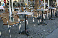 Tables outside a café Paris France<br />