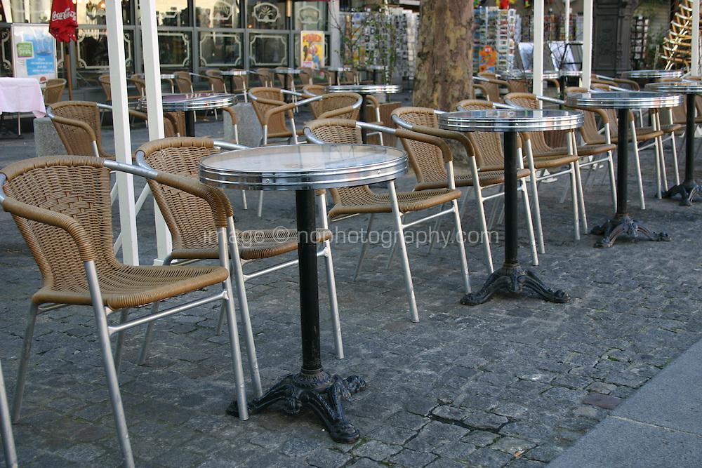 Tables outside a café Paris France<br />