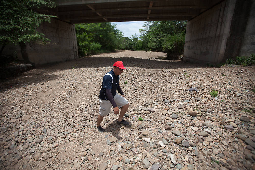 Maryan Alvarez in the Tecomapa River, in La Pavana, Somotillo, Nicaragua. One of many rivers in the area of northern Nicaragua that haven't had a flow of water in them for years.
