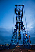 The cable car moves across the top of the Tees Transporter Bridge, Middlesbrough, North Yorkshire, United Kingdom. The Transporter Bridge is the longest remaining transporter in the world at 851 feet.