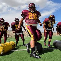 081114  Adron Gardner<br /> <br /> The Tohatchi Cougars maneuver between bags during football practice in Tohatchi Monday.