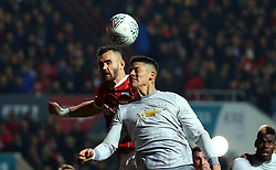 Bailey Wright of Bristol City challenges Marcos Rojo of Manchester United to a header - Mandatory by-line: Robbie Stephenson/JMP - 20/12/2017 - FOOTBALL - Ashton Gate Stadium - Bristol, England - Bristol City v Manchester United - Carabao Cup Quarter Final