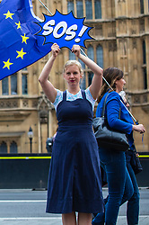 """© Licensed to London News Pictures. FILE PICTURE: 03/09/2019. London, UK. Avaaz campaigner ANTONIA STAATS takes part in an anti """"no deal"""" photocall outside Parliament . Antonia Staats has reportedly been in a relationship with Government scientist Neil Ferguson, which involved the breaking of lockdown rules. Photo credit: Rob Pinney/LNP"""