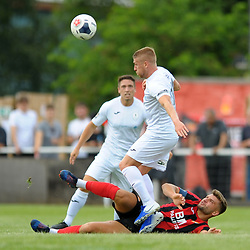 TELFORD COPYRIGHT MIKE SHERIDAN Darryl Knights goes in for a tackle with Kettering's Michael Richens during the National League North fixture between Kettering Town and AFC Telford United at Latimer Park on Saturday, August 3, 2019<br /> <br /> Picture credit: Mike Sheridan<br /> <br /> MS201920-005