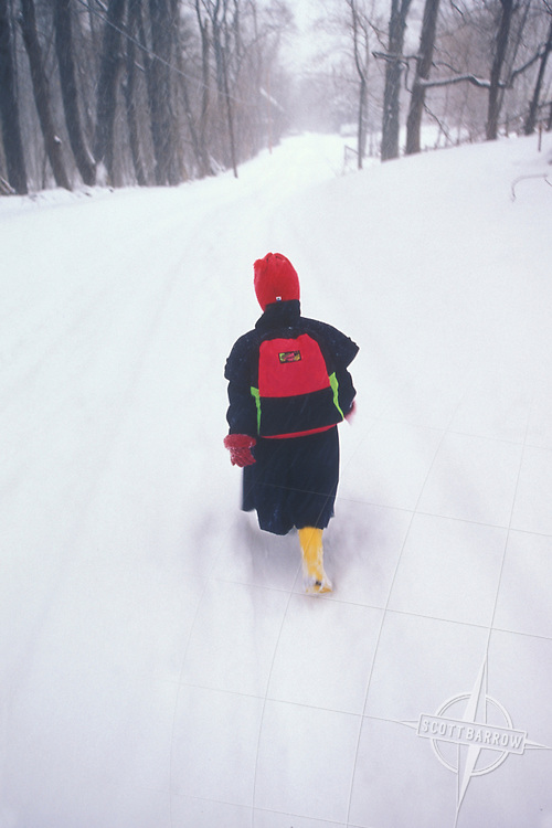 Girl walking to school in the snow