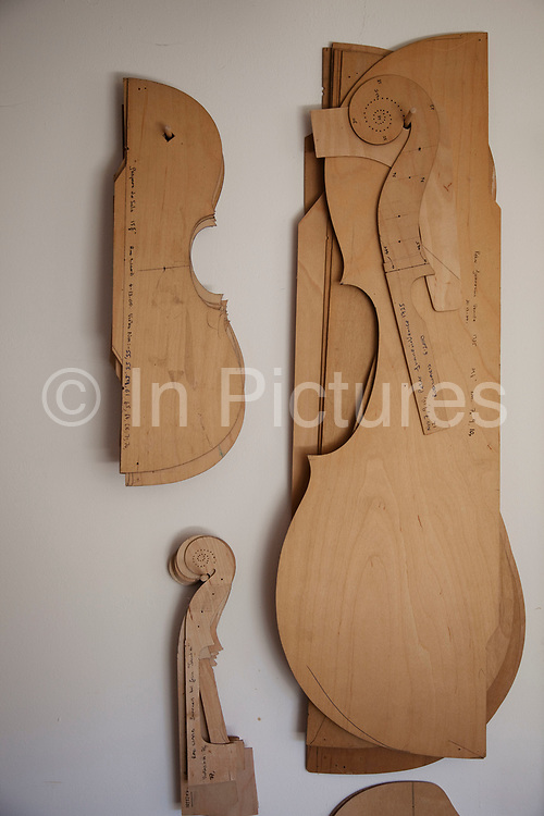 Templates for various violins, cellos and violas. Violins being made at viloin an cello maker, Rod Ward's studio in Guilden Morden, Hertfordshire, UK. This highly skilled craft involves the process of making from raw wood to final instrument. All hand crafted with specialist tools and care for detail.