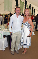 NICK JONES and KIRSTY YOUNG at the Cartier International polo at Guards Polo Club, Windsor Great Park, on 30th July 2006.<br /><br />NON EXCLUSIVE - WORLD RIGHTS