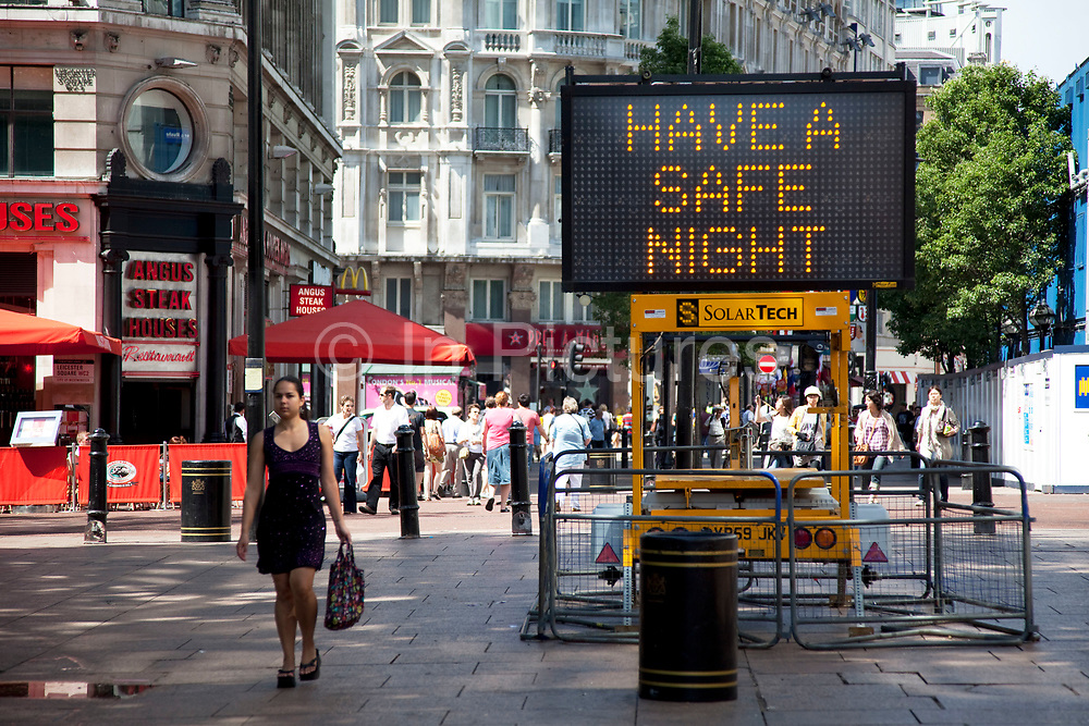 Public announcement / warning sign in Leicester Square, a hugely popular area for tourism in the West End, London. The words say 'Have a safe night' urging people to take care and be vigilant against crime.