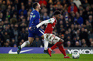 Ainsley Maitland-Niles of Arsenal (R) holds off Eden Hazard of Chelsea (L). Carabao Cup , semi final 1st leg match, Chelsea v Arsenal at Stamford Bridge in London on Wednesday 10th January 2018.<br /> pic by Steffan Bowen, Andrew Orchard sports photography.