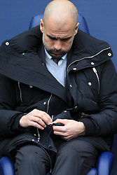 5th February 2017 - Premier League - Manchester City v Swansea City - Man City manager Pep Guardiola struggles with the zip on his coat jacket - Photo: Simon Stacpoole / Offside.