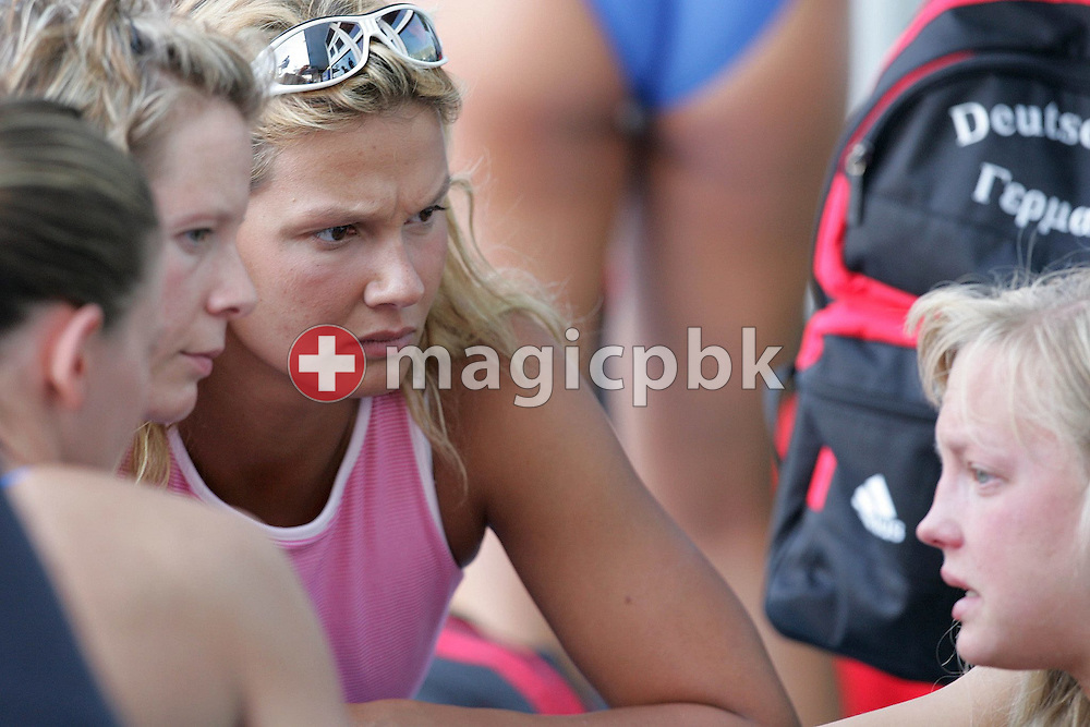 German swimmer Franziska Van Almsick (C) and teammates listens to another teammate Annika  Mehlhorn (R)  who cries over the rejection of her entry in the 100 meter butterfly by FINA during a training session at the Olympic Pool in Athens, Thursday 12 August 2004. Mehlhorn missed the Olympic A-limit in the qualifying races.   (Photo by Patrick B. Kraemer / MAGICPBK)