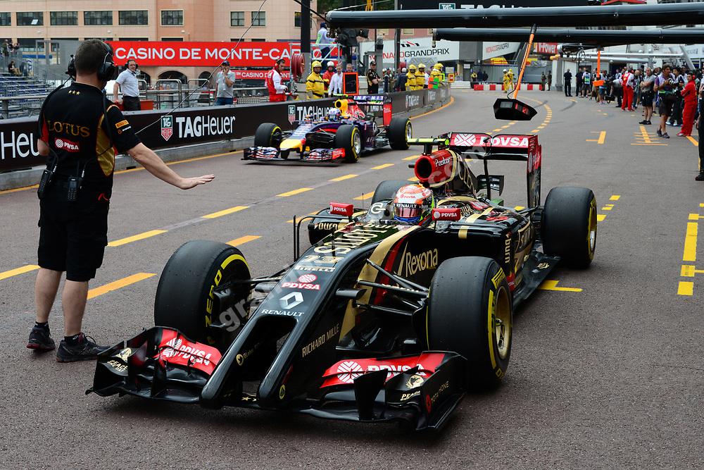 Pastor Maldonado (Lotus-Renault) and Daniel Riccioardo (Red Bull-Renault) in the pits during practice for the 2014 Monaco Grand Prix. Photo: Grand Prix Photo