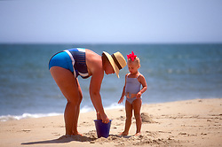 Unidentified mother and daughter play in the sand, Monday, Aug. 19, 2019 at Henlopen Acres Beach Club in Rehoboth Beach, Del. (Photo by D. Ross Cameron)