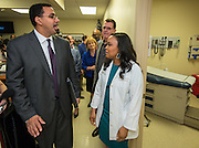 Acting US Secretary of Education John King, left, and Houston ISD Superintendent Dr. Terry Grier, center, talk with Teresa Harris, right, in the Memorial Hermann clinic at Sharpstown High School, January 15, 2016.