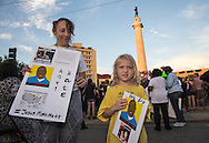 Theodore Boekiner, 6 at his first protest  with his mother Karel Sloane-Boekinder in New Orleans at Lee Circle against police brutality following the killing of Alton Sterling in Baton Rouge and Philando Castile in Minnesota on July 8, the day after 5 police officers will killed by a sniper in Dallas.