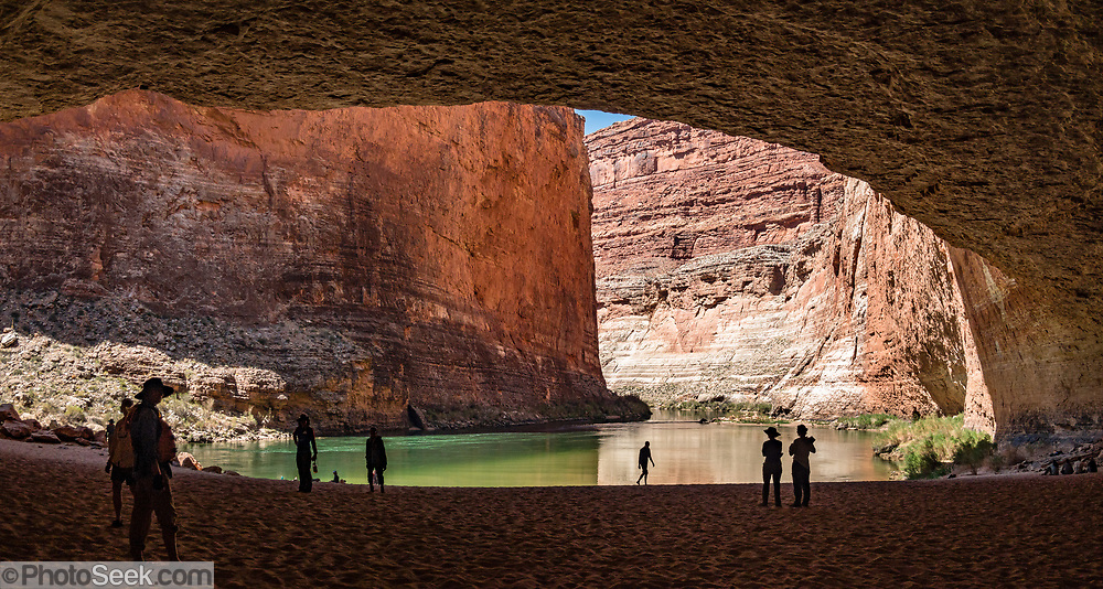 """Redwall Cavern at River Mile 33.3, seen while rafting through Marble Canyon on day 2 of 16 days boating 226 miles down the Colorado River in Grand Canyon National Park, Arizona, USA. Marble Canyon runs from Lees Ferry at River Mile 0 to the confluence with the Little Colorado River at Mile 62, which marks the beginning of the Grand Canyon. Although John Wesley Powell knew that no marble was found here when he named Marble Canyon, he thought the polished limestone looked like marble. In his words, """"The limestone of the canyon is often polished, and makes a beautiful marble. Sometimes the rocks are of many colors – white, gray, pink, and purple, with saffron tints."""" Multiple overlapping photos were stitched to make this panorama."""