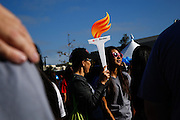 Participants carry torch cutouts in remembrance of loved ones during the 2014 Silicon Valley Heart & Stroke Walk at KLA-Tencor in Milpitas, California, on October 11, 2014. (Stan Olszewski/SOSKIphoto)
