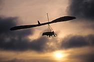 Hang glider at sunset, Fort Funston, Golden Gate National Rec. Area, San Francisco, California