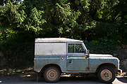 Old Land Rover in Guiting Power in The Cotswolds, United Kingdom. Guiting Power is a small village in Gloucestershire. The population taken at the 2011 census was 296. The Cotswolds is an area in south central England. The area is defined by the bedrock of limestone that is quarried for the golden coloured Cotswold stone. It contains unique features derived from the use of this mineral; the predominantly rural landscape contains stone-built villages and historical towns.