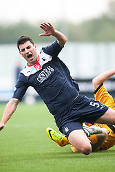 Falkirk's Jonathan Flynn tackled by Dumbarton's Mitchell Megginson.<br /> Falkirk 1 v 2 Dumbarton, Scottish Championship game played today at the Falkirk Stadium.<br /> ©Michael Schofield.