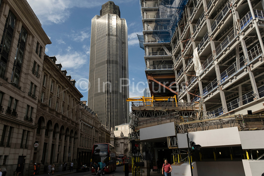 View looking up at the construction site for the latest skyscraper in the City of London at 8 Bishopsgate near to Tower 42, once the Nat West Tower on 2nd July 2021 in London, United Kingdom. As the coronavirus lockdown continues its process of easing restrictions, the City remains far quieter than usual, which asks the question if normal numbers of people and city workers will ever return to the Square Mile.