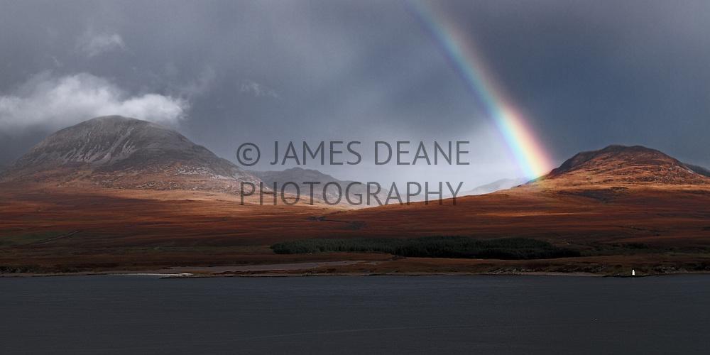 An Autumn rainbow during a rainstorm. Photographed from the Bunnahabhain Road, Isle of Islay