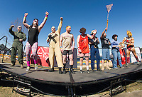 "Team Shrivel takes to the stage in their ""80's theme"" for the costume parade just before heading into the lake for the 8th annual Winni Dip for Special Olympics at the Margate Beach on Saturday.  (Karen Bobotas/for the Laconia Daily Sun)"