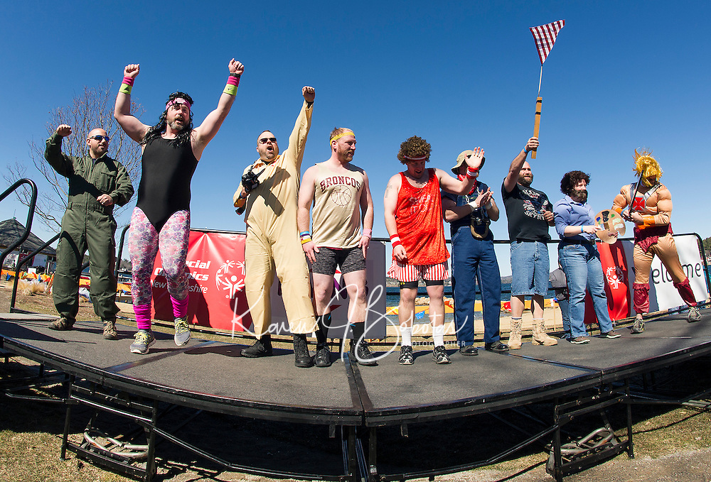 """Team Shrivel takes to the stage in their """"80's theme"""" for the costume parade just before heading into the lake for the 8th annual Winni Dip for Special Olympics at the Margate Beach on Saturday.  (Karen Bobotas/for the Laconia Daily Sun)"""