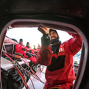 Leg 3, Cape Town to Melbourne, day 01, Willy Altadill puts up the spray screen on board MAPFRE. Photo by Jen Edney/Volvo Ocean Race. 10 December, 2017.