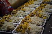 A meal made with rice, meat, potatoes and beans is served in Crackland, near Manguinhos shantytown, Rio de Janeiro.