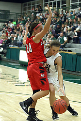 10 January 2015:  ? defended by Kasey Kleiner during an NCAA women's division 3 CCIW basketball game between the Carthage Reds and the Illinois Wesleyan Titans in Shirk Center, Bloomington IL