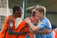 Southend United forward Simon Cox  (10) (middle) celebrates his goal (0-2) with a fan during the EFL Sky Bet League 1 match between Gillingham and Southend United at the MEMS Priestfield Stadium, Gillingham, England on 13 October 2018.