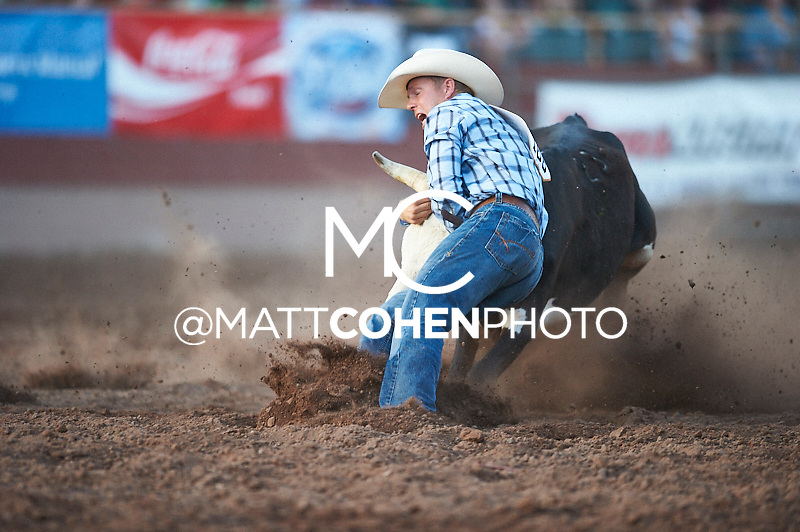 Steer wrestler Barry Kreikemeier of Jackson, WY competes at the Pikes Peak or Bust Rodeo in Colorado Springs, CO.<br /> <br /> <br /> UNEDITED LOW-RES PREVIEW<br /> <br /> <br /> File shown may be an unedited low resolution version used as a proof only. All prints are 100% guaranteed for quality. Sizes 8x10+ come with a version for personal social media. I am currently not selling downloads for commercial/brand use.
