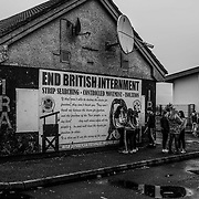 """Teens of the mostly Catholic Creggan neighborhood of Londonderry congregate on a Sunday afternoon. Many of the children have expressed their distrust for the PSNI (Police Service Northern Ireland) where studies found """"Between 2010 and 2018, stop and search powers have been used approximately 30,000 times against children – under 18's""""  Northern Ireland, September 2019."""