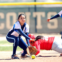 041313       Adron Gardner/Independent<br /> <br /> Window Rock Scout Jolynn Charley (12), left,  scoops up a throw as Monument Valley Mustang Briana Hudgins (18) dives for second base and Desire Fonseca (16) looks on  in Fort Defiance Saturday.
