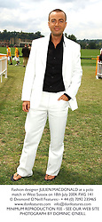Fashion designer JULIEN MACDONALD at a polo match in West Sussex on 18th July 2004.PXG 141