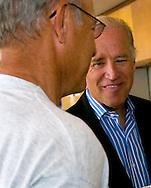 8/16/06 Des Moines. IA Sen. Joseph Biden speaks with Rich Haak, who was eating dinner near  an anti Wal Mart event in Des Moines Wednesday afternoon.  Haak spoke with Sen. Biden after the event. (Chris Machian/Prairie Pixel Group)