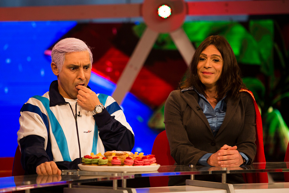 Israeli comic actors Yuval Semo (R), who plays the role of Israeli Parliament Member Miri Regev of the Likud Party and Mariano Idelman (L), who plays the role of Israeli Prime Minister Benjamin Netanyahu, are seen during a filming of an episode of the top-rated Israeli satirical show 'Eretz Nehederet', Hebrew for 'Wonderful Country' at a television studio in Herzliya, Israel, on January 26, 2015.