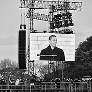 Thousands watch on the JumboTron as President-elect Barack Obama speaks in front of the Lincoln Memorial during the We Are One concert.
