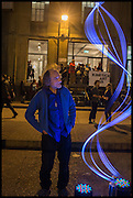 PAUL FRIEDLANDER WITH WAVE OUTSIDE THE ENTRANCE TO Kinetica Art Fair, Truman Building, Brick Lane, London. London. 16 October 2014