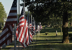 May 26, 2017 - Sioux City, IOWA, USA - Flags on display for Memorial Day at Graceland Park Cemetery in Sioux City Friday, May 26, 2017. (Credit Image: © Jerry Mennenga via ZUMA Wire)