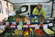 Fruit and vegetable grower Henry Johnson, who sells mainly home produced fruit and veg from his mobils stall business. Local community Sunday market in the village of Husthwaite, North Yorkshire, England, UK. Over 20 stalls with a mixture of old favourites and new stalls lelling locally made products.